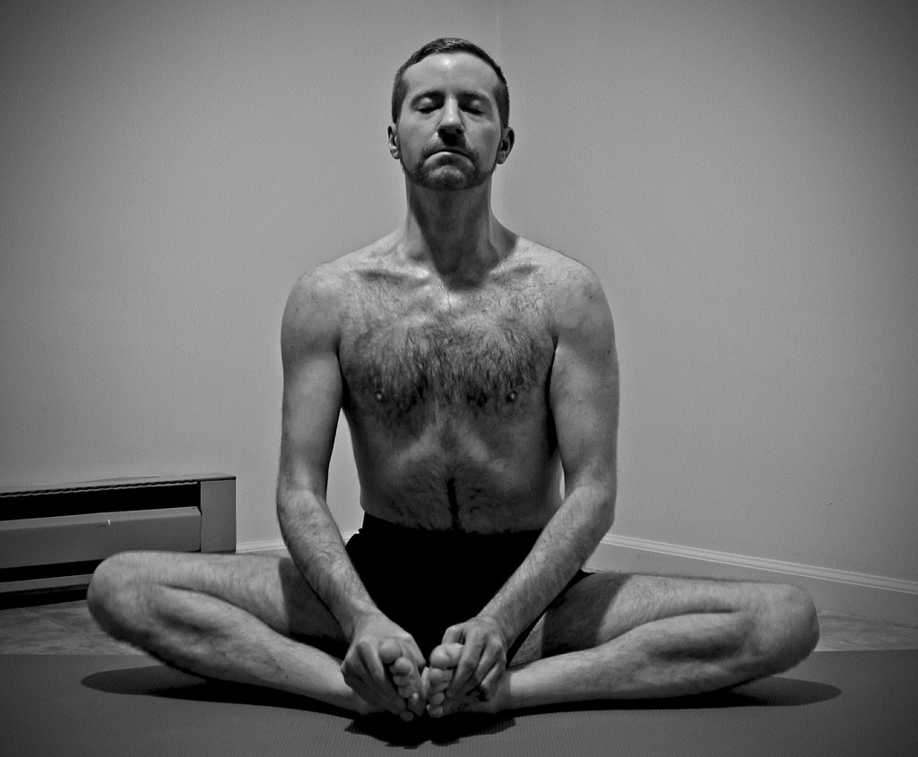Man in Cobbler's Pose - Baddha Konasana