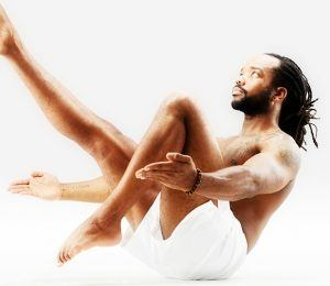 male wellness man doing yoga boat pose